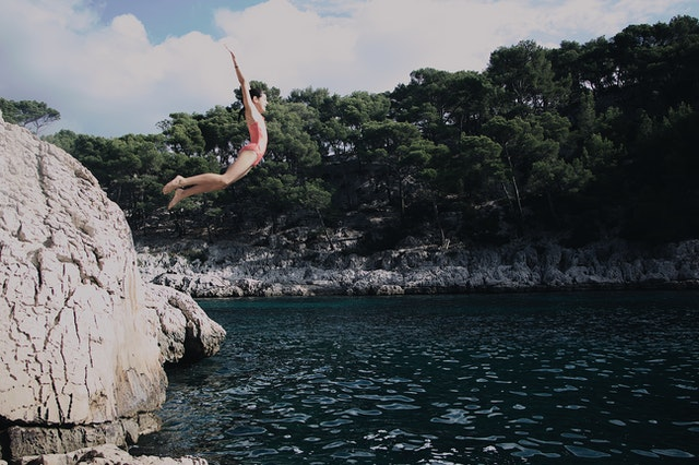 child jumping off cliff