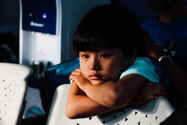 child staring sadly